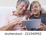 couple of senior people using... | Shutterstock . vector #221540902