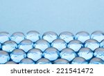 Glass Beads On Blue Background