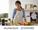 smiling young woman  mixing... | Shutterstock . vector #221544382