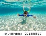 Cute Teenage Boy Swimming...