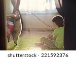 a little cute boy playing with... | Shutterstock . vector #221592376