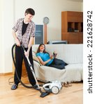 young man cleaning with vacuum... | Shutterstock . vector #221628742