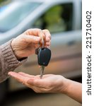 woman giving car keys to... | Shutterstock . vector #221710402