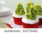 Christmas decorated cupcakes - stock photo