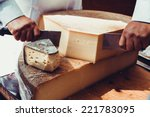 Worker Slicing The Cheese....