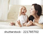 Mother With Her Baby Playing O...