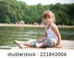 young girl sitting sitting in a ... | Shutterstock . vector #221842006