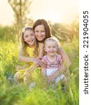 portrait of young happy mother... | Shutterstock . vector #221904055