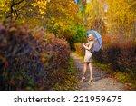 girl fall park  trees umbrella | Shutterstock . vector #221959675