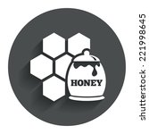 honey in pot and honeycomb sign ...