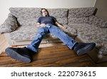adult man resting in sofa like... | Shutterstock . vector #222073615
