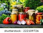Jars Of Pickled Vegetables In...