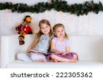 two sisters happy with a new... | Shutterstock . vector #222305362