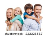 Stock photo happy to be a family happy family of four bonding to each other and smiling while standing against 222328582