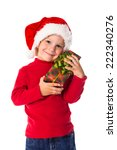 Little boy in christmas hat with green gift box, isolated on white - stock photo