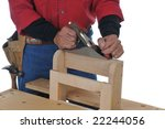 Woodworker using block plane isolated over white - stock photo