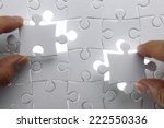 puzzle piece coming down into... | Shutterstock . vector #222550336