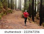 man running in forest woods... | Shutterstock . vector #222567256