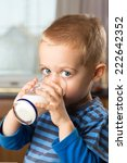 young boy drinking milk out of... | Shutterstock . vector #222642352