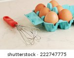 wire whisk and brown eggs on... | Shutterstock . vector #222747775