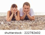 couple sitting on a  sand... | Shutterstock . vector #222782602