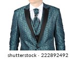 Fashionable mens suit with a blue-green floral pattern, designed for a wedding or prom, isolated on white background. - stock photo