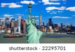 The Statue of Liberty and Manhattan Midtown Skyline USA - stock photo