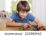 young boy playing with a toy... | Shutterstock . vector #222985942