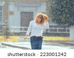 rain city happy girl jumping in ... | Shutterstock . vector #223001242