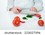 cook chopped parsley for salad | Shutterstock . vector #223027396
