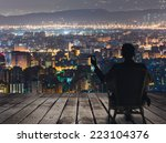 silhouette of businessman sit... | Shutterstock . vector #223104376