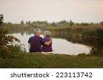 Happy Senior Couple Sitting In...