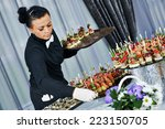 waiter with meat dish serving... | Shutterstock . vector #223150705