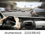 Man\'s Hands Of A Driver On...