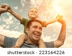 son seating on the father under ... | Shutterstock . vector #223164226