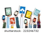 hands holding digital devices... | Shutterstock . vector #223246732