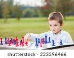 elegant young boy in white... | Shutterstock . vector #223296466