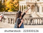 tourism  girl show something by ... | Shutterstock . vector #223333126