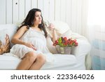 pretty pregnant woman drinking... | Shutterstock . vector #223364026