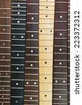 Six Guitar Necks Aligned ...