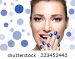 Happy people. Beautiful young woman laughing with hands on face covering half mouth. Perfect skin. Professional manicure and makeup. High Fashion Portrait. Nail Art and Makeup Concept - stock photo