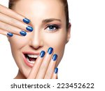 Happy people. Beautiful young woman laughing with hands on face. Perfect skin. Professional manicure and makeup. High Fashion Portrait isolated on white with copy space for text. - stock photo