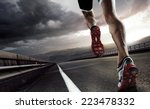 Stock photo sport runner feet running on road closeup on shoe 223478332
