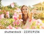 Stock photo woman throwing rose petals 223519156