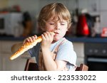 Little Boy Eating Long Loaf...