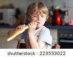 Little Boy Eating Long Loaf...