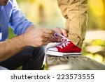 father is helping his son to... | Shutterstock . vector #223573555
