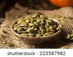 raw organic pumpkin pepita... | Shutterstock . vector #223587982