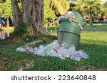 Overflowing Green Garbage Bin
