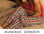 young woman in bed suffering... | Shutterstock . vector #223663276